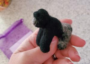 felt gorilla with silver gray fur on back legs